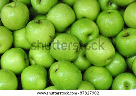 Green Apple Background, shallow depth of field. - stock photo