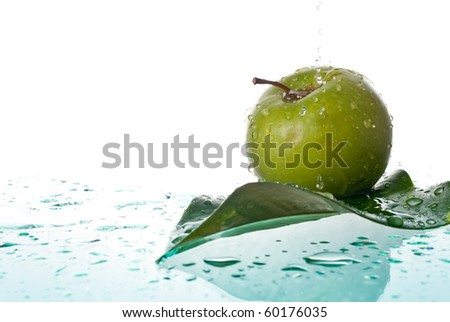 Green Apple Being Showered in Clean Water - stock photo