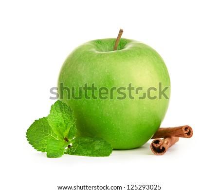 Green apple, cinnamon sticks and mint leaves - stock photo