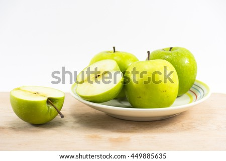 Green apple dish on wood and white background,Fruit for health and Hi-vitamin and low calorie and suitable for diet food. - stock photo