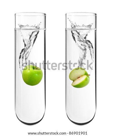 Green apple dropped in chemical test tube, Biotechnology, Genetically Modified Organisms - stock photo