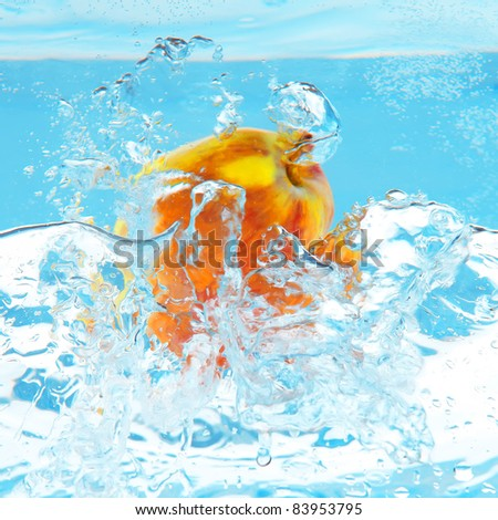 green apple fall in real blue water splash isolated over white background