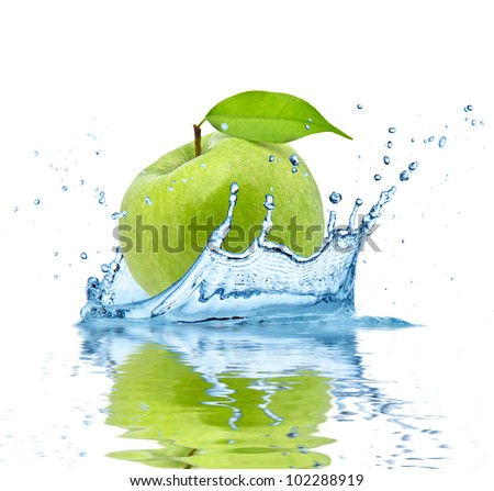 Green apple falling into water, isolated on white background