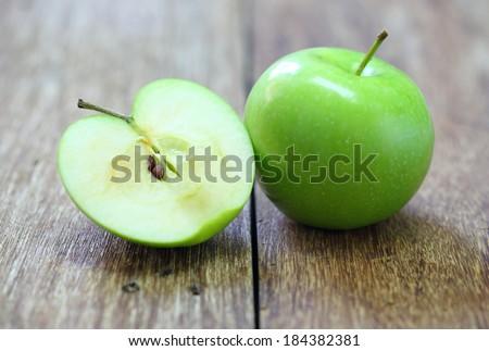 green apple fruit on wood background - stock photo