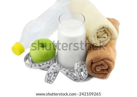 Green apple,glass of milk and measuring tape isolated on white. Exercise and healthy diet concept. - stock photo