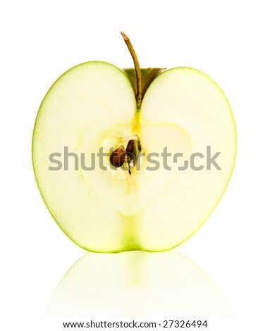 Green apple half over white background with reflection