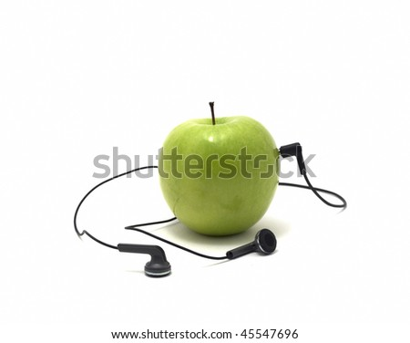green apple in which headphones are connected