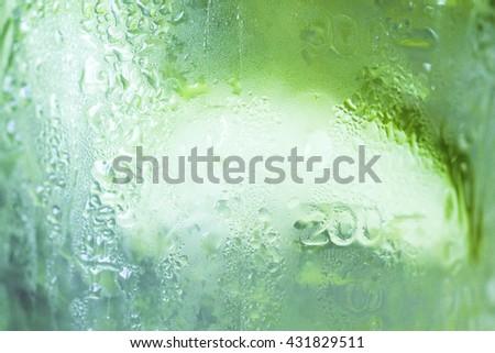 Green apple juice in glass,apple juice background,Fresh apple juice.Red juice splash. - stock photo