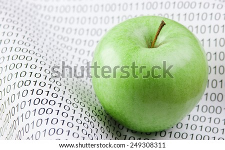 green apple on a binary code - stock photo