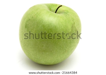 green apple on a white