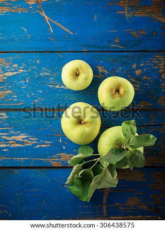 Green apple on the blue wooden table. Top view. - stock photo