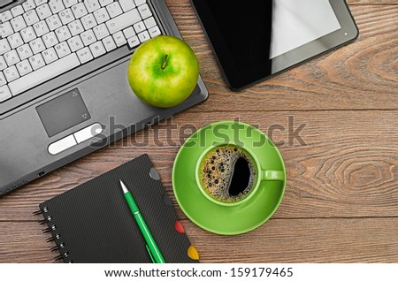 green apple on worplace - stock photo
