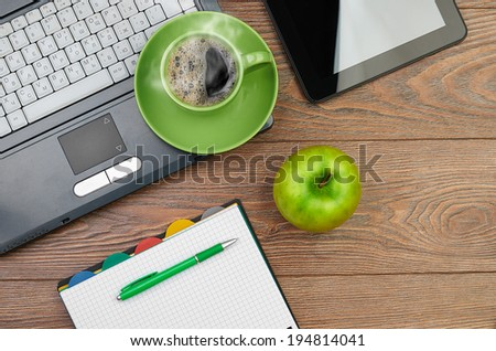 green apple on worplace - stock photo