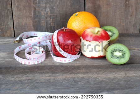 Green apple, Red apple. Fruit Diet concept on a wooden floor.