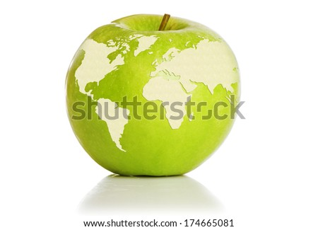 Green apple representing earth isolated on white background - stock photo
