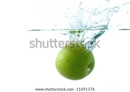 green apple splashing into cold water- against white