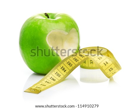 green apple with a heart symbol against white background - stock photo