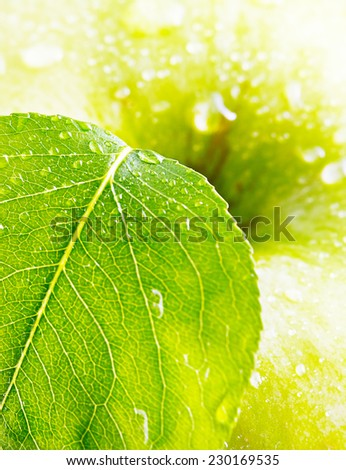 Green Apple With A Leaf Close Up