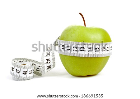 green apple with a measuring tape and heart symbol isolated on white background