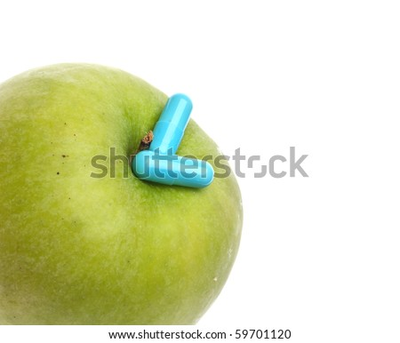 Green Apple with Blue Pills Isolated on White.