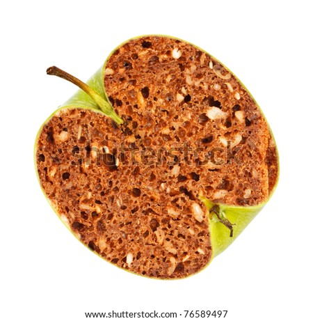 green apple with bread inside, genetically modified organism - stock photo