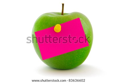 Green apple with bright pink memo sticker isolated on white - stock photo