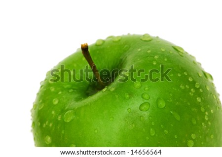 Green apple with dew isolated on white