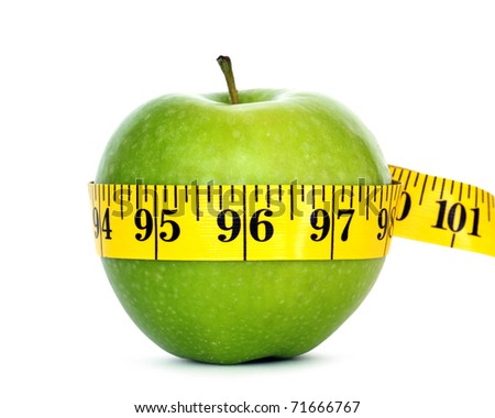 green apple with measure tape - stock photo