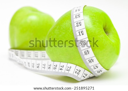 Green apple with measurement