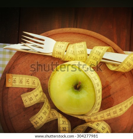 Green apple with measurement  - stock photo