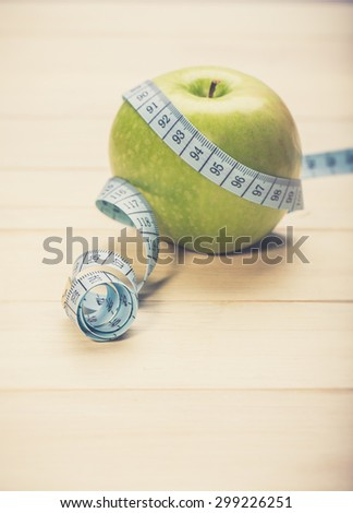 Green apple with measurement i - stock photo