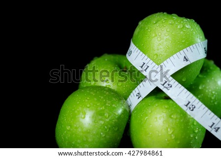 Green apple with measurement isolated on Black background - stock photo