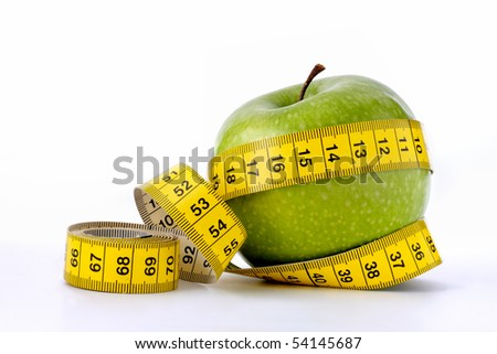 Green apple with measuring tape - stock photo