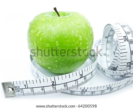 Green Apple with measuring tape on white background - stock photo