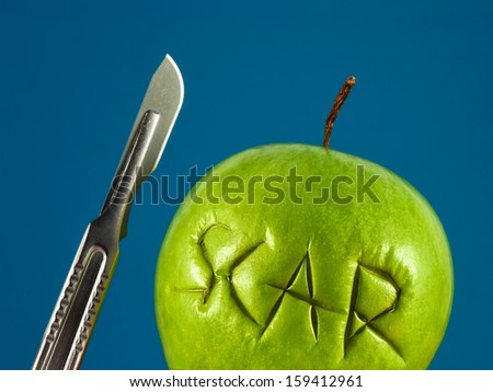 Green apple with Scar and scalpel. Failure plastic surgery. Removal of scars. Recovery after surgery. Unprofessional surgeon. Medical concept. - stock photo