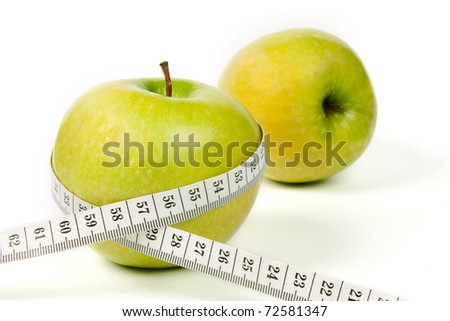 Green apple with tape on white background - stock photo