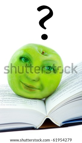 Green apple with the human face on the book - stock photo