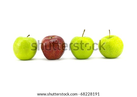 green apple with the red one standing isolated on white background