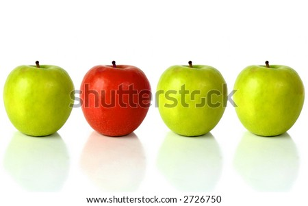green apple with the red one standing out from the crowd - over a white background with reflection - stock photo