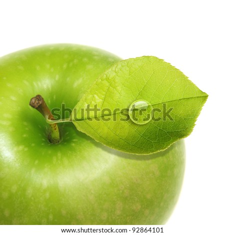 Green apple with water drop isolated - stock photo