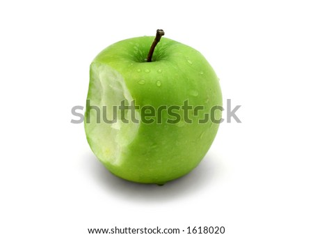 Green apple with water drops and bite