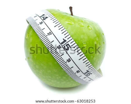 Green Apple with water drops and measuring tape on white background