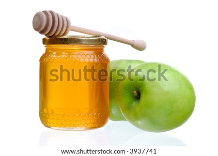 Green Apples And A Jar Of Golden Light Honey With A Honey Dipper, Jewish New Year Symbols - stock photo
