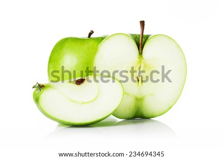 Green apples and apple slices isolated on white background. - stock photo