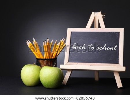 green apples and  blackboard with back to school text on it - stock photo