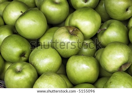 Green apples for sale at the market - stock photo