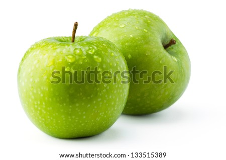 Green apples Granny Smith covered in water droplets isolated against a white background.