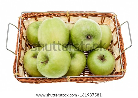 Green apples in a basket isolated - stock photo