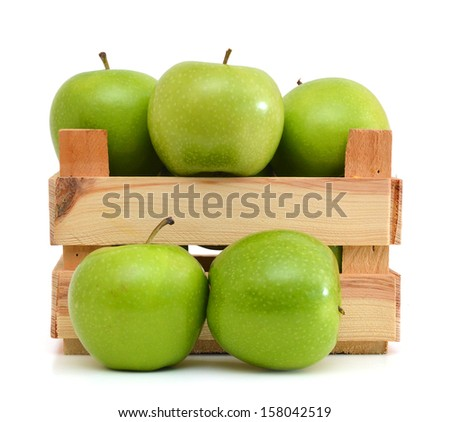 Green apples in wooden crate - stock photo