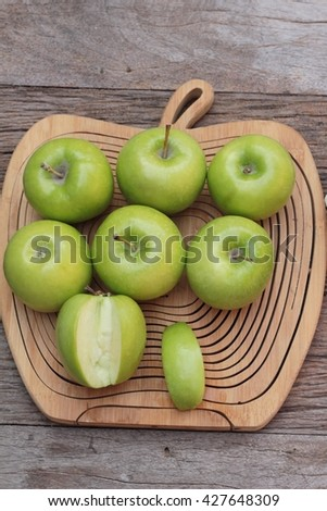 green apples is delicious on wood background - stock photo